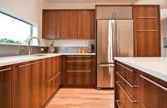 kitchen, white counter, wood cabinets, mid century | Keeping the Character: A Mid-Century Remodel