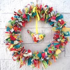 If you are looking for something unique, handmade and totally gorgeous to brighten up YOUR home this festive season... you will love this special wreath!  Large 250cm wire ring, with literally hundreds of pieces of torn fabric layered around it to form a gloriously 3d wreath! $65.00