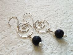 Volcanic Stone Earrings Lava Rock and Pearl. $23.00, via Etsy.