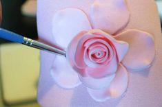 A gumpaste flower tutorial.  Adding Third Layer to Gum Paste Rose