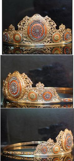 CLASSICAL 18TH CENTURY TIARA. France circa 1770. 18K red gold and silver. The ornaments are enameled in an orange color. Several ornaments around the tiara are set with rose cut diamonds. French hallmarks dating around 1770. The ornaments where the Tiara is built around date back to the 18th century. Most probably they came from another piece of jewelry and somewhere in the nineteenth century these ornaments were used for decoration in this tiara.