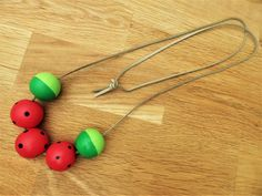 Lauriepops thinks all accessories should look good enough to eat! This hand painted, 5 bead, watermelon necklace certainly satisfies the appetite. Wooden Bead Necklaces, Wooden Beads, Watermelon Painting, Garland Ideas, Good Enough To Eat, Beaded Garland, Pom Poms, Beaded Necklace, Manualidades