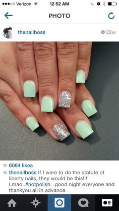 mint green and silver sparkles on the ring finger.