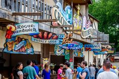 Multicolored signs advertising food at Scarborough Renaissance Festival in Waxahachie, Texas