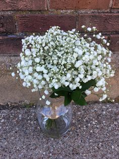 Loved it! Pinned it! A Blooming Envy Design! Wedding Bouquet designed Baby's Breath.