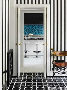 Montgomery 1 marble floor tiles by Ann Sacks mixed with Block Print Stripe wallpaper by Farrow & Ball. Design: Hillary Thomas and Jeff Lincoln. Photo: Eric Piasecki. housebeautiful.com. #entry #foyer #black_and_white #stripes #marble_tiles