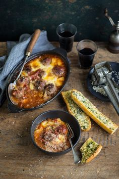 A delicious baked meatball recipe with easy garlic bread #recipe #Italian #mince