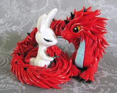 This is my dream wedding cake topper! The rabbit is my zodiac year and my fiance's is the dragon :). Perfect!
