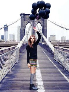 Black balloons never looked so good. - Nimue Smit Poses on the Brooklyn Bridge in New Images for H Divided Look Rock, Nyc, Black Balloons, Latex Balloons, Anna Dello Russo, New Image, Brooklyn Bridge, Empire State Building, Yorkie