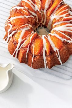 Fresh summer peaches turn sticky and sweet when baked in the bottom of a Bundt pan with butter and brown sugar. After you place the peach slices in the ridges of the pan, gently spoon the cake batter over the fruit, then smooth the top with an offset spatula.