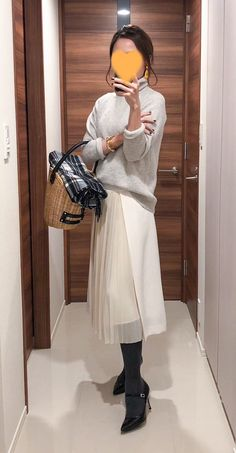 Coat: Des Pres Grey sweater: MUJI Long skirt: Der Pres Scarf: Johnstones Bag: Babylone Pumps: Fabio Rusconi