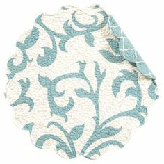 """Add a touch of charm to your tablescape with this reversible cotton placemat, showcasing a scalloped edge and quilted detailing. Use it to offset colorful dishware, or let it complement an all-white tablescape.    Product: PlacematConstruction Material: CottonColor: Blue and whiteDimensions: 17"""" DiameterCleaning and Care: Machine washable"""