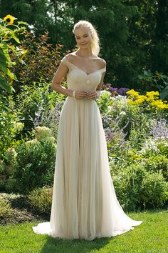 Sweetheart Gowns Style 11029 - Soft, romantic tulle wedding dress. A-line wedding gown with romantic off the shoulder straps. Flowy tulle a-line skirt wedding dress.