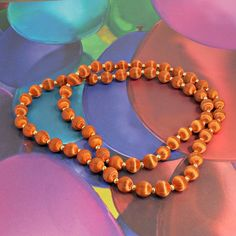 Necklace one strand rust color satin covered beads goldtone tiny ones 31 inch #Unbranded #StrandString