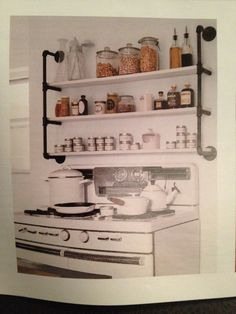Shelves made with pipes. Country Living October 2013 issue.