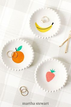 Put a spin on an ordinary jewelry dish with these scalloped creations. Made of clay and fruit temporary tattoos, these sweet-inspired appreciation gifts are another ideal way for your child's teacher to store their prized pieces of jewelry. #marthastewart #diydecor #diyprojects #diyideas #handmadegiftideas