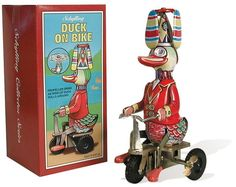 This happy duck pedals his bike while his hat propeller spins with brilliant colors. Schylling Wind-Up Duck on Bike Antique Toys, Vintage Toys, Vintage Metal, Duck On A Bike, Toy Rocket, Bike Reviews, Rubber Tires, Tin Toys, Metal Toys