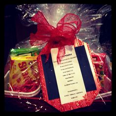 Raffle prize idea- Movie night basket has a few boxes of traditional movie theater candy, bag of microwaveable popcorn, and prepaid tickets to a local movie theater.