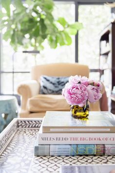 Coffee table styling // pearl inlay tray, books and some fresh flowers