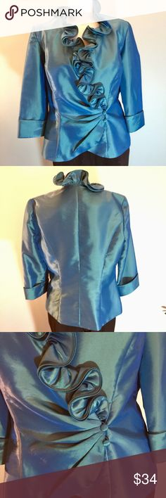 """Blue Satin Ruffled Blouse/Jacket Worn once, this blouse/jacket is in perfect condition. Beautiful ruffle and button closure details. 3/4 length sleeves. 50% nylon/50% polyester. Lined. Machine wash cold. Bust 38"""" (with lots of give because of design and cut), length of jacket 22.5"""", arm length 18"""". Alex Evenings Jackets & Coats"""