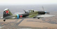Flying Heritage Collection-Ilyushin II-2M3 Shturmovik.FHC's Il-2 constructed in Kuybyshev mid-1943 & assigned to 828th Attack Aviation Regiment on lower Karelian Front.Oct 10,1944,hit by anti-aircraft fire while attacking airfield & crashed near Titovka River.Discovered in nameless lake by searchers scouting area with helo in 1991.When recovery crew raised it to surface,found still had rockets & bombs under iwings.Restored using parts of 4 wrecks.