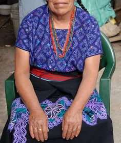 Blue Huipil Chiapas    a woman from the town of Zinacantan Chiapas is wearing an embroidered  huipil from San Andres Larrainzar, another Maya community