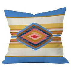 Bring a pop of style to your sofa or favorite reading nook with this eye-catching pillow, featuring a Southwestern-inspired motif. Made in the USA.