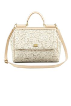A ladylike Dolce & Gabbana handbag fits right in at brunch