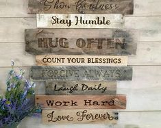 Rustic wood wall art made for you and your family! Family rules and values are wood burned onto planks of reclaimed wood. A real statement piece for your home! #farmhousedecor #diningroomdecor #largewoodwallart #largewoodwalldecor #reclaimedwoodwallart