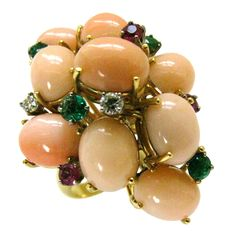 A Coral and Gemstone Cocktail Ring c1960 | From a unique collection of vintage cocktail rings at http://www.1stdibs.com/jewelry/rings/cocktail-rings/