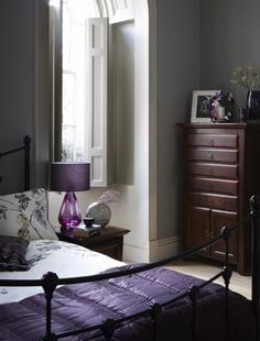 bedroom | light gray walls with white accents + purple, wrought iron bed and dark furniture