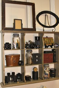 Shelf for old cameras.  Love the photos displayed in ball jars!