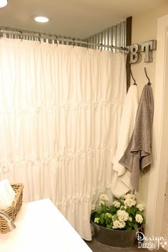 Farmhouse bathroom IKEA style! There is just something about a farmhouse that is homey and inviting. I particularly like the shower curtain. Could I make something similar?