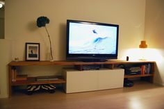 Found this hack on IkeaHackers.net. Made to measure Bestå and oak TV bench - IKEA Hackers