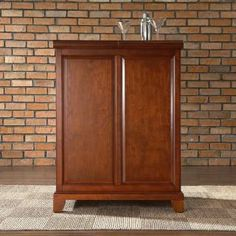Check out the Crosley Furniture KF40001CCH Newport Expandable Bar Cabinet in Classic Cherry Finish priced at $450.00 at Homeclick.com.