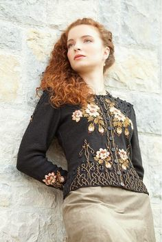 Embroidered knitted cardigan. Charcoal grey with rose designs.
