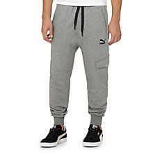 You've got the latest technologies, the latest music, the latest  everything . Now, it's time to do something about those outdated sweats. Yes, we see them. Get the latest in style and in all things comfy with our new Cargo Sweatpants.  Features:   80% Cotton, 20% polyester  Wide elastic waistband with draw cord for a comfort and style  Loose fit with closed cuffs for optimized freedom of movement  Two front pockets and buttoned pocket at lower left leg  PUMA Cat Logo at left ...
