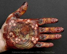 Another CCJ, using mehndi/henna, indigo, turmeric, and apickling powder combo to add different colors to this celtic hand.