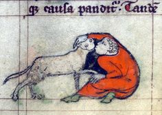 Kissing a cat, book of hours, Flanders 14th century (Baltimore, The Walters Art Museum, W.88, f. 40r)