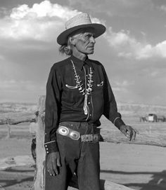 photo by Don Blair of an elderly man in traditional Navajo dress wearing a concho belt turquoise necklace and straw hat