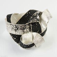 Yasutaka Okamura (BA) - bracelet  2011, kimono fabric, fine silver - Germany, Pforzheim, Fachhochschule