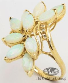Excellent 14K Yellow Gold Opal and Diamond Bypass Cluster Ring 7.0 US Estimated Retail $850 - 0.0225 cttw - 6.3 Grams