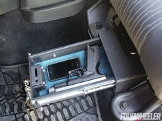 Jeep wrangler under seat lock box. This would be a good idea for a pickup truck seat also!