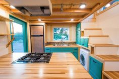Laura's x Tiny House on Wheels by MitchCraft Tiny Homes Tiny House Movement // Tiny Living // Tiny House on Wheels // Tiny House Stove // Tiny Home Kitchen // Tiny Home // Architecture // Home Decor Tiny House Builders, Tiny House Plans, Tiny House On Wheels, Tiny Cabins, Cabins And Cottages, Small Room Design, Tiny House Design, Tiny Houses For Sale, Little Houses
