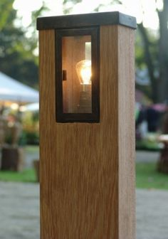 Wooden bollard lighting for the garden