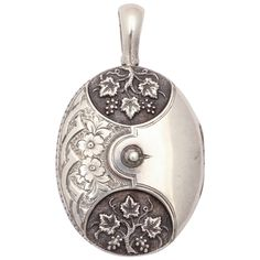 Sterling Silver Victorian Locket to Button Up Your Memories | From a unique collection of vintage drop necklaces at https://www.1stdibs.com/jewelry/necklaces/drop-necklaces/