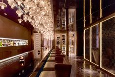 Raffles Hotel in Istanbul, Turkey designed by Hirsch Bedner Associates (HBA). Lighting design by Illuminate. For the restaurants, Rocca and Arola, the lighting evolves throughout the day which reflects and mimics the colourful exterior views.