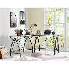 Update your home office with the sleek and modern Altra Lacklan Glass Top L Desk. The 3-piece glass-top desk features stunning frosted glass and a black, powder-coated metal frame and legs that'll add an elegant yet simple touch to your office. This L-shaped glass desk will fit perfectly in the corner to maximize the room's space and create an open, organized layout. The spacious desktop also provides an abundant amount of workspace for a computer, paperwork and other office supplies. Altra…