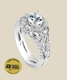 JCK Jewelers Choice Award Winner: Best Bridal Ring 2008. A New Leaf: commence your journey together with this Lyria Bridal design featuring intertwining leaves and vines. A contouring diamond band flows in harmony with this ring. Diamond Info: 56-RD 0.66, 02-RD 0.11 CTS Fits center stone size RD: 6.0-6.5 MMGUIDE Center stone not included.