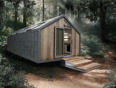 Prefab Camo Cabin: Modern Mobile Metal-Clad Trailer Home:          If you saw it sitting in the landscape, you would be hard-pressed to guess that this metal, wood and glass house designed by the Hangar Group has hidden mobility – let alone that it was secretly prefabricated in a factory and shipped to its site...